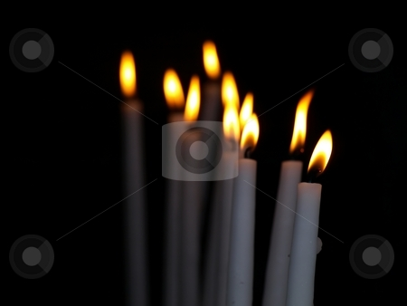 Candles burning stock photo, Candles burning during prayers in Lourdes by Laurent Dambies