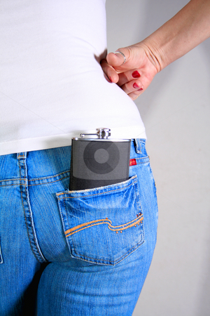 Hip Flask 3 stock photo, Hip flask in reap pocket of woman's jeans. by Clay Anthony