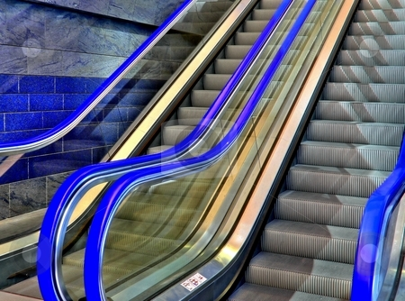 Blue escalator  stock photo, Blue  escalator in a shopping mall by Laurent Dambies