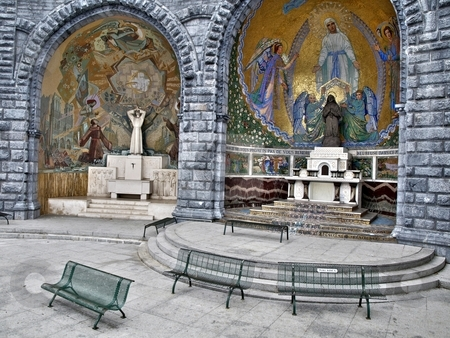 Catholic Pilgrimage stock photo, Prayer area just outside the Grotto in Lourdes by Laurent Dambies
