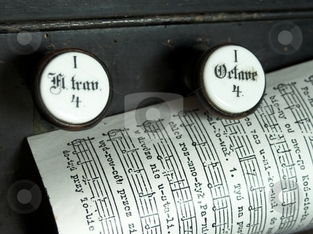 Music sheet page on the top of a church organ stock photo, Music sheet on the top of a church organ with octave keys by Laurent Dambies
