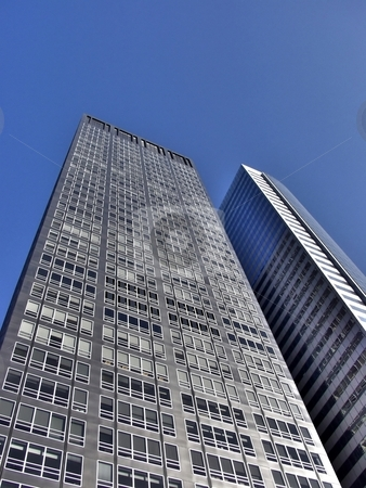 Two skyscrapers street view stock photo, Two modern skyscrapers under clear blue sky by Laurent Dambies