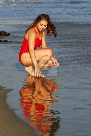 Lady at the Beach stock photo, Young hispanic woman enjoying the beach by Timothy OLeary