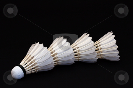 Badminton Shuttlecocks stock photo, Four badminton shuttlecocks against a black background by Inge Schepers