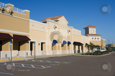 Upscale pastel commercial mall stock photo, Upscale pastel strip mall with awnings and corner clock tower by Lee Barnwell