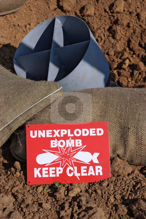 Unexploded Bomb stock photo, Mock unexploded bomb and sign from the Second World War, with sand bags by Paul Phillips