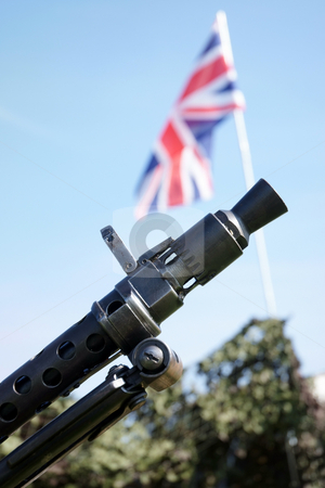 Battle stock photo, Machine gun used in the Second World War with the Union Jack flag in background by Paul Phillips