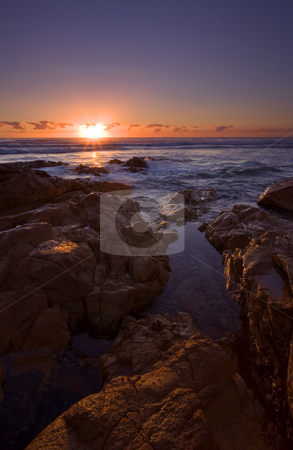 Coolum Sunrise stock photo, A bit of first light dancing over the sandstone boulders lining a beach near Coolum in Queensland, Australia. by Mike Dawson