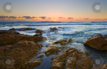 Coolum Dawn stock photo, Cooum Beach and the sandstone rocks made wet by high tide glow under the first light of a glorious new Day down under. by Mike Dawson