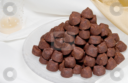 Chocolate Truffles stock photo, A plate of gourmet truffles ready for consumption. by Robert Byron