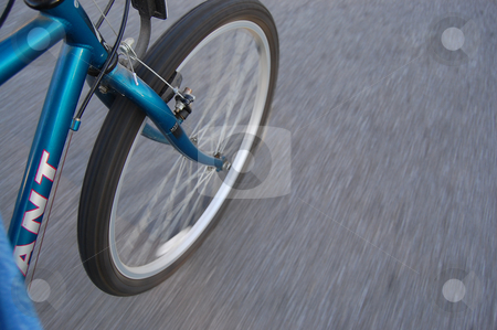 Silo of bike riding down the road stock photo, Silo of blue mountain bike riding down the road. by Heather Shelley
