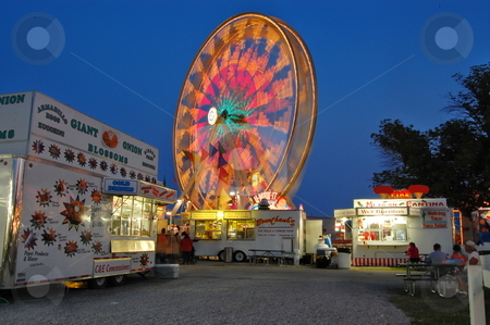 Ferris Wheel at dusk at the county fair stock photo, Ferris wheel at dusk at the county fair in Goshen Indiana USA by Heather Shelley