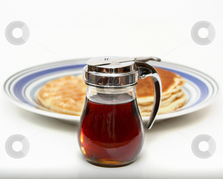 It's All About The Syrup stock photo, Composit illustration of syrup dispenser in foreground with OOF plate behind with short-stack of pancakes on right and waffle on left. by Clay Anthony