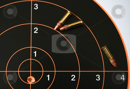 Target shoot 1 stock photo, Target with bullet hole on bullseye plus three .22 caliber bullets. by Clay Anthony