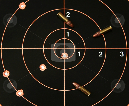 Target Shoot 4 stock photo, Target with bullet hole on bullseye plus three .22 caliber bullets. by Clay Anthony