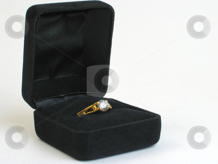 Ring box stock photo, Diamond ring displayed in open black ring box on white background. by Clay Anthony