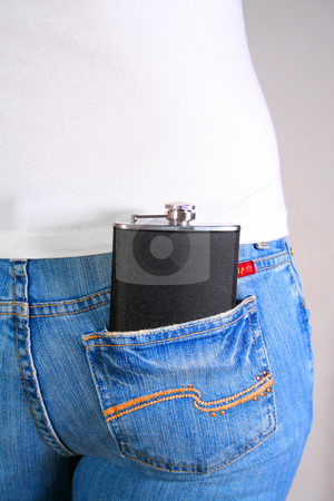 Hip Flask 1 stock photo, Hip flask in reap pocket of woman's jeans. by Clay Anthony
