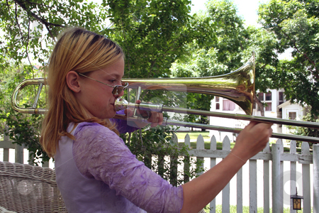 Natural trombonist 2 stock photo, Pre-teen girl with sunglasses playing trombone outside. by Clay Anthony