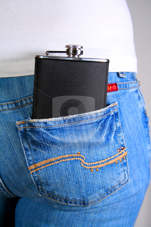 Hip Flask 2 stock photo, Hip flask in reap pocket of woman's jeans. by Clay Anthony