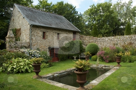A peaceful French country garden stock photo,  by Mark Smith