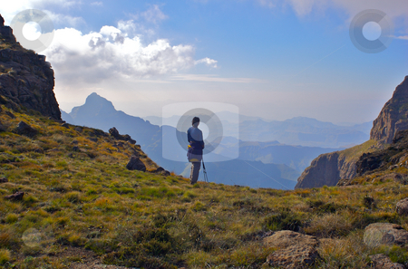 A fit young woman looks out over beautiful distant mountains stock photo,  by Mark Smith