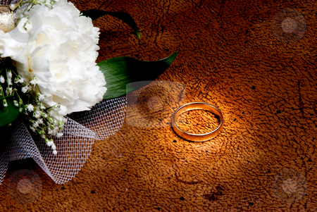 Wedding Ring stock photo, A wedding ring next to the grooms corsage. by Robert Byron