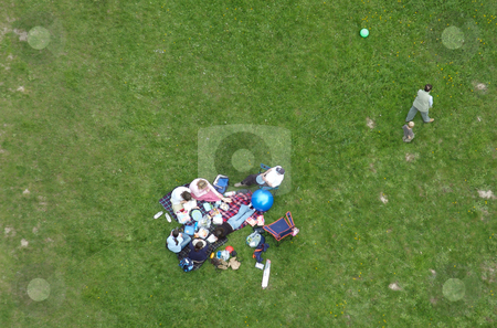 Leaving the picnic - overhead shot of a family group stock photo,  by Mark Smith