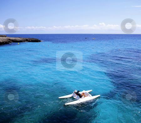 Pedal Boat stock photo, Pedal boat just off the coast of Menorca, one of Spain's Baleric islands by Paul Phillips