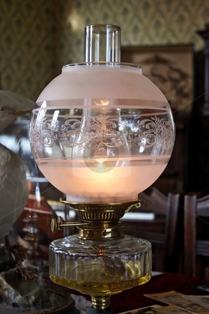 Oil Lamp stock photo, An old oil lamp on a period table setting by Paul Phillips