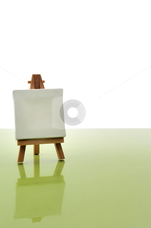 Wood easel stock photo, Little wood easel and white canvas by Csaba Zsarnowszky