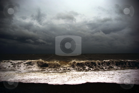 Storm stock photo, View of rough sea and dark sky from a beach by David Nebesky