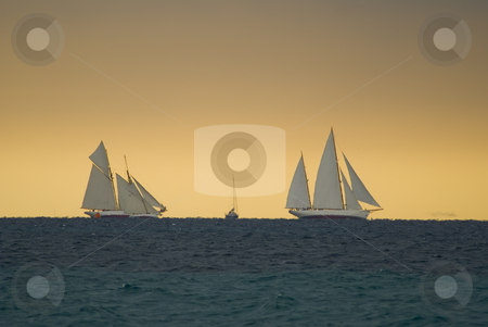 Regattas under  storm stock photo, Old sailboats  in Cannes bay during