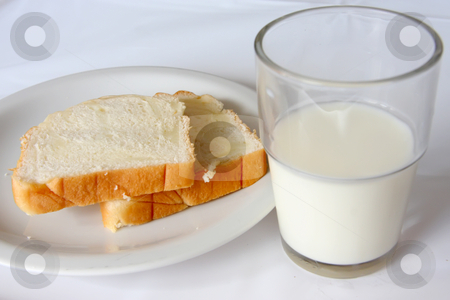 Bread and milk stock photo, Sliced bread and a glass of milk healthy snack by Kheng Guan Toh