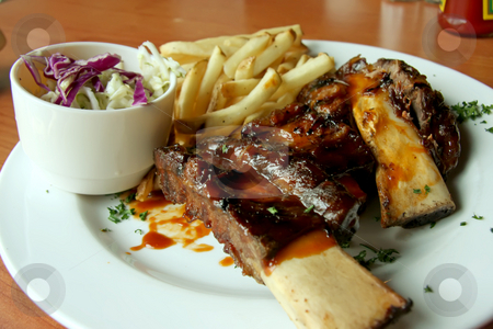 Beef ribs stock photo, Barbecued beef ribs with french fries on white plate by Kheng Guan Toh