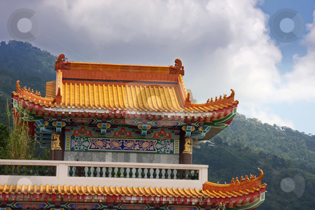 Stormy temple stock photo, Traditional chinese buddhist temple against dark storm clouds by Kheng Guan Toh