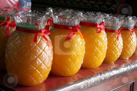 Temple offerings stock photo, Yellow wax candles in the shape of pineapples chinese temple offerings by Kheng Guan Toh