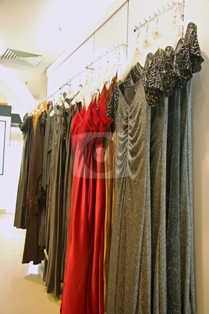 Dresses for sale stock photo, Fashion clothing retail display women's fancy dresses clothes for sale by Kheng Guan Toh