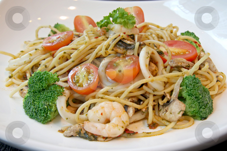 Seafood pasta stock photo, Seafood pasta with prawns and mushrooms on white plate by Kheng Guan Toh
