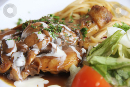 Chicken with pasta stock photo, Roast chicken with pasta and salad and gravy by Kheng Guan Toh