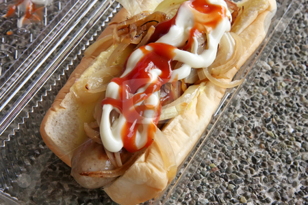 Hot dog stock photo, Hotdog fastfood sausage in bun with condiments by Kheng Guan Toh