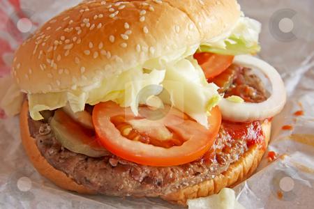 Fastfood burger stock photo, Fastfood hamburger bun on paper wrapper by Kheng Guan Toh