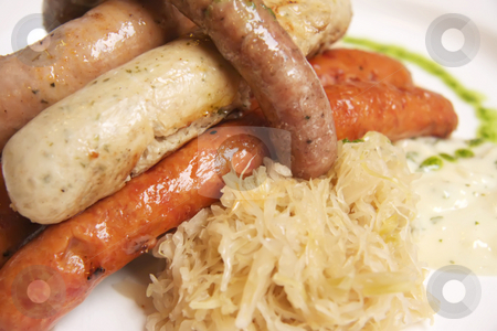 German sausages stock photo, German sausages cooked on plate with saurkraut by Kheng Guan Toh