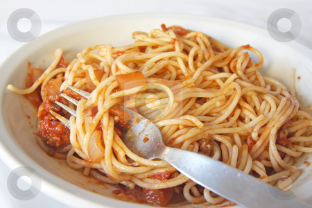 Spaghetti stock photo, Spaghetti with tomato sauce with fork and plate by Kheng Guan Toh