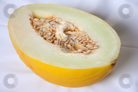 Yellow melon stock photo, Yellow melon cut in half fresh fruit by Kheng Guan Toh