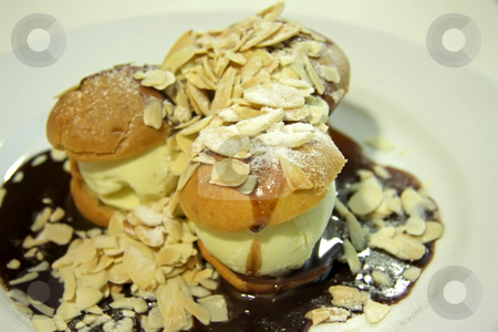 Profiteroles stock photo, Profiteroles with ice cream and chocolate suace with nuts by Kheng Guan Toh