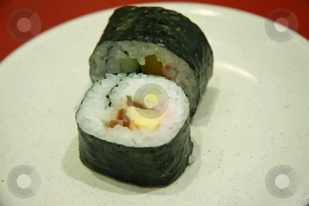 Maki roll slices stock photo, Maki roll slices traditional japanese cuisine rice dish by Kheng Guan Toh