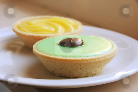 Lemon and lime tarts stock photo, Lemon  and lime pastry tarts sweet sour cream baked dessert by Kheng Guan Toh