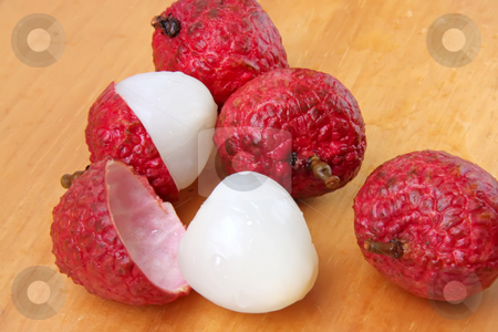 Lychee fruits stock photo, Lychee fruits fresh whole pile unpeeled and peeled by Kheng Guan Toh