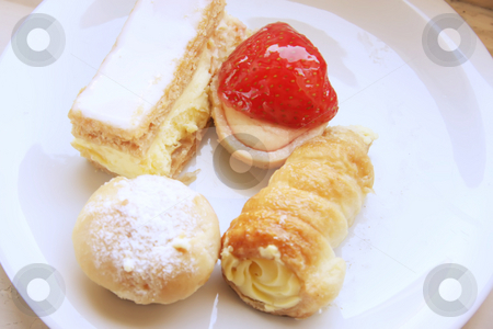 Assorted fancy pastries stock photo, Assorted fancy cream pastry desserts on white plate by Kheng Guan Toh