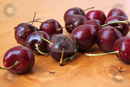 Fresh cherries stock photo, Fresh whole cherries with stalk on wooden background by Kheng Guan Toh